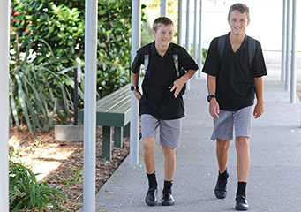 Grey shorts, Black Polo knit shirts, socks and lace-up shoes